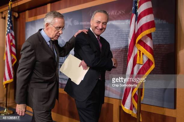 Senate Majority Leader Harry Reid and Sen Chuck Schumer leave after talking to reporters about the use of the 'nuclear option' at the US Capitol...
