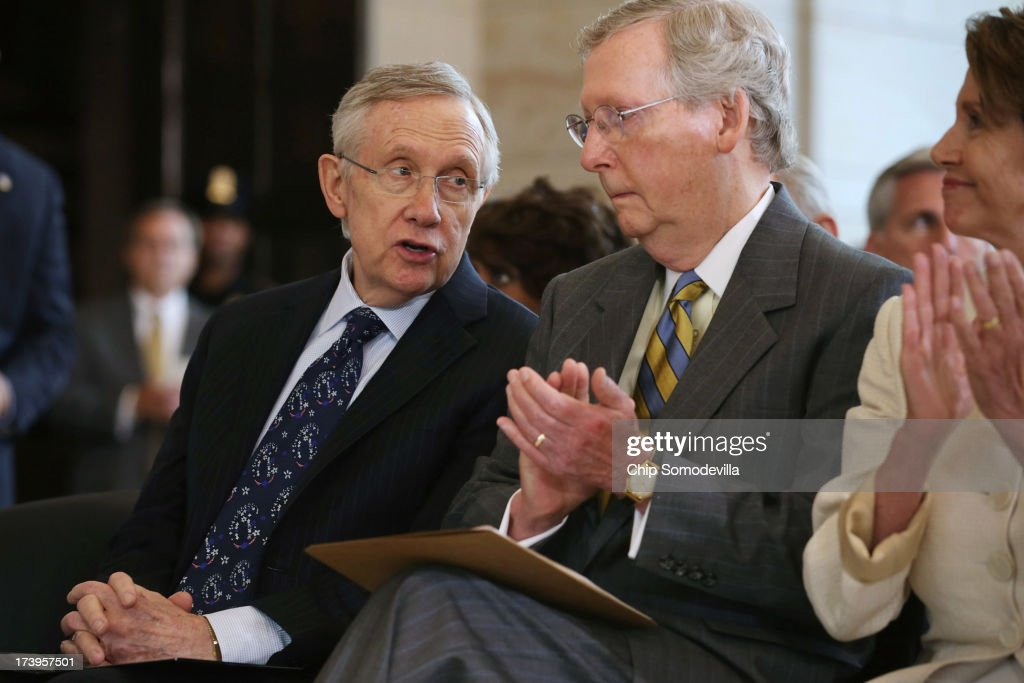 Senate Majority Leader <a gi-track='captionPersonalityLinkClicked' href=/galleries/search?phrase=Harry+Reid+-+Politician&family=editorial&specificpeople=203136 ng-click='$event.stopPropagation()'>Harry Reid</a> (D-NV) (L) and Senate Minority Leader <a gi-track='captionPersonalityLinkClicked' href=/galleries/search?phrase=Mitch+McConnell&family=editorial&specificpeople=217985 ng-click='$event.stopPropagation()'>Mitch McConnell</a> (R-KY) speak during a ceremony to celebrate the life Nobel Peace Prize laureate and former South Africa President Nelson Mandela on the occasion of his 95th birthday in the U.S. Capitol Visitor Center July 18, 2013 in Washington, DC. July 18 is Nelson Mandela Day, during which people are asked to give 67 minutes of time to charity and service in their community to honor the 67 years Mandela gave to public service. Mandela was admitted to a South African hospital June 8 where he is being treated for a recurring lung infection.