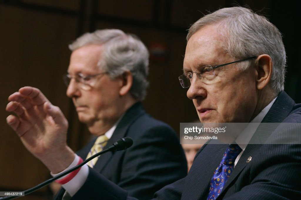 Senate Majority Leader <a gi-track='captionPersonalityLinkClicked' href=/galleries/search?phrase=Harry+Reid+-+Politician&family=editorial&specificpeople=203136 ng-click='$event.stopPropagation()'>Harry Reid</a> (D-NV) (R) and Senate Minority Leader <a gi-track='captionPersonalityLinkClicked' href=/galleries/search?phrase=Mitch+McConnell&family=editorial&specificpeople=217985 ng-click='$event.stopPropagation()'>Mitch McConnell</a> (R-KY) testify before the Senate Judiciary Committee about political donations and freedom of speech in the Hart Senate Office Building June 3, 2014 in Washington, DC. Liberal political groups delivered boxes filled with two million petitions calling for a campaign finance constitutional amendment and pushing for '...a proposed constitutional amendment to restore the ability of Congress and the states to regulate the raising and spending of money in elections.'