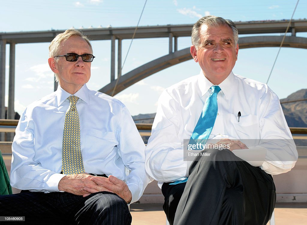 U.S. Senate Majority Leader <a gi-track='captionPersonalityLinkClicked' href=/galleries/search?phrase=Harry+Reid+-+Politician&family=editorial&specificpeople=203136 ng-click='$event.stopPropagation()'>Harry Reid</a> (D-NV) (L) and U.S. Transportation Secretary <a gi-track='captionPersonalityLinkClicked' href=/galleries/search?phrase=Ray+LaHood&family=editorial&specificpeople=598728 ng-click='$event.stopPropagation()'>Ray LaHood</a> attend the dedication of the Mike O'Callaghan-Pat Tillman Memorial Bridge part of the Hoover Dam Bypass Project October 14, 2010 in the Lake Mead National Recreation Area, Nevada. The 1,900-foot-long structure sits 890 feet above the Colorado River, about a quarter of a mile downstream from the Hoover Dam. The USD 240 million project to relieve vehicle traffic on the Hoover Dam began in 2003, and is scheduled to be open to traffic by next week.