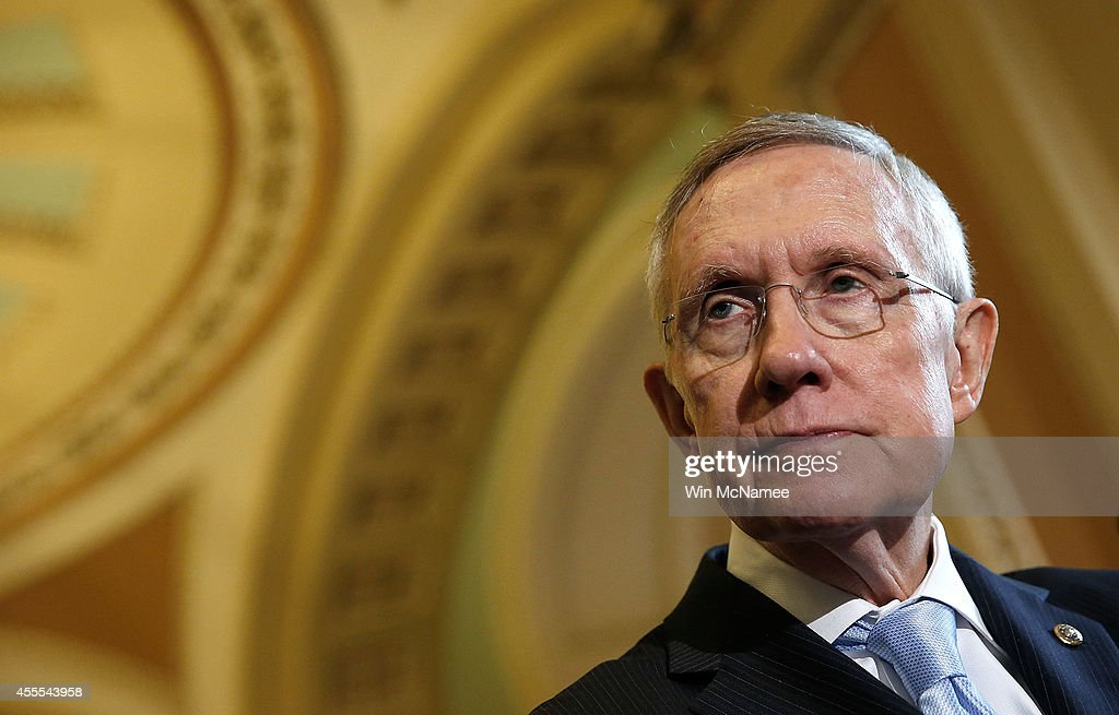 Senate Majority Leader <a gi-track='captionPersonalityLinkClicked' href=/galleries/search?phrase=Harry+Reid&family=editorial&specificpeople=203136 ng-click='$event.stopPropagation()'>Harry Reid</a> (D-NV) answers questions following the weekly Democratic policy luncheon at the U.S. Capitol September 16, 2014 in Washington, DC. Reid answered questions about the midterm elections and the remaining legislative agenda for the Senate.