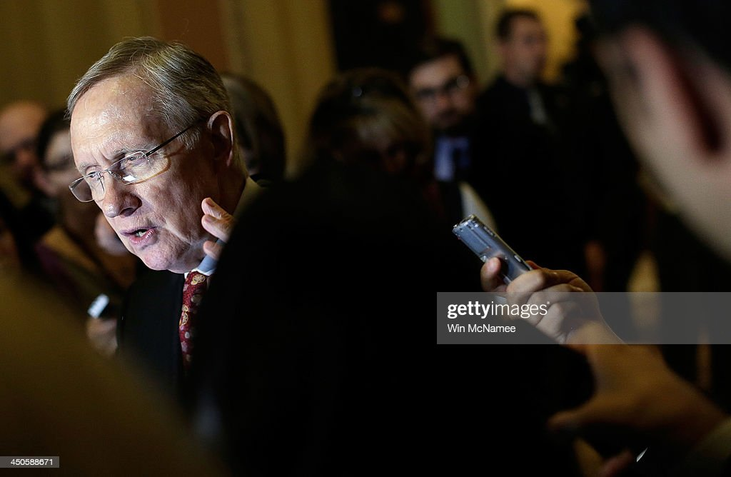 S Senate Majority Leader Harry Reid answers questions from reporters following the weekly policy lunch of the Democratic caucus November 19 2013 in...