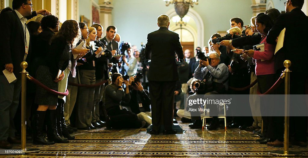 Senate Majority Leader Harry Reid answers reporters' questions during a news conference after the weekly Senate Democratic Policy Committee meeting...