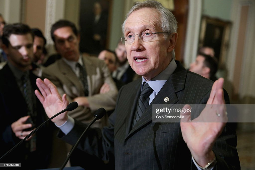 Senate Majority Leader Harry Reid answers reporters' questions during a brief news conference after attending the Senate Democratic Caucus policy...