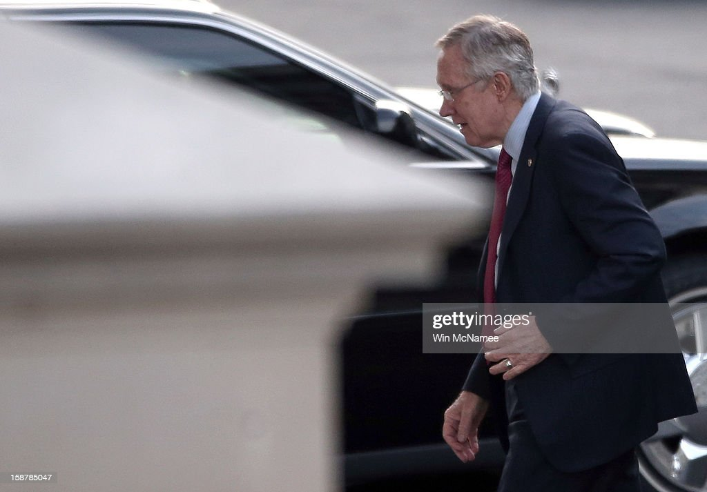 Senate Majority Leader <a gi-track='captionPersonalityLinkClicked' href=/galleries/search?phrase=Harry+Reid+-+Politician&family=editorial&specificpeople=203136 ng-click='$event.stopPropagation()'>Harry Reid</a> (D-NV) arrives at the White House prior to meeting with U.S. President Barack Obama and other Congressional leaders December 28, 2012 in Washington, DC. Obama and members of Congress continue to seek a solution to avert the possibility of large tax increases combined with deep spending cuts, also known as the 'fiscal cliff'.