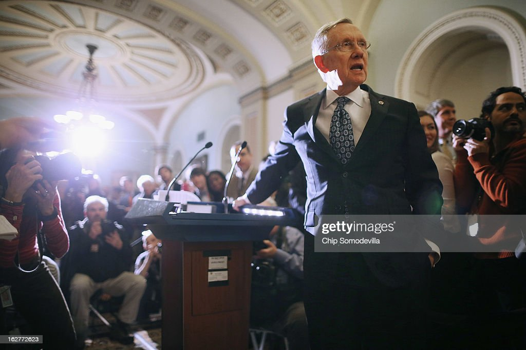 Senate Majority Leader <a gi-track='captionPersonalityLinkClicked' href=/galleries/search?phrase=Harry+Reid+-+Homme+politique&family=editorial&specificpeople=203136 ng-click='$event.stopPropagation()'>Harry Reid</a> (D-NV) asks for quiet while talking to reporters after the weekly Senate Democratic policy luncheon at the U.S. Capitol February 26, 2013 in Washington, DC. Reed said that finding a solution to the sequestration lies with the House Republicans and that Speaker of the House John Boehner (R-OH) was wrong when he said, 'We should not have to move a third bill before the Senate gets off their ass and begins to do something.'