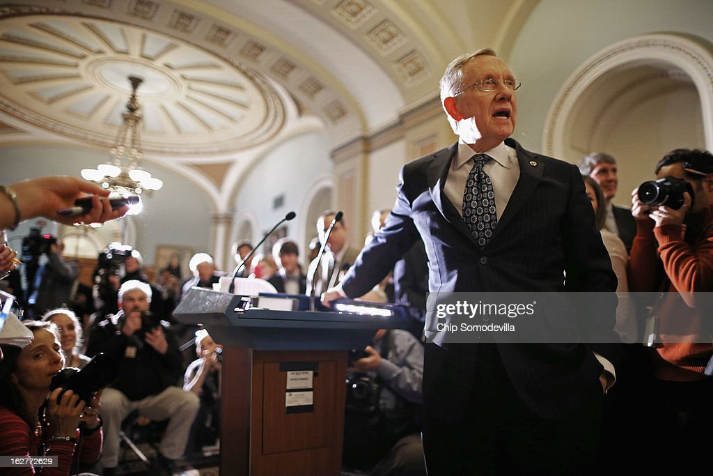 Senate Majority Leader <a gi-track='captionPersonalityLinkClicked' href=/galleries/search?phrase=Harry+Reid&family=editorial&specificpeople=203136 ng-click='$event.stopPropagation()'>Harry Reid</a> (D-NV) asks for quiet while talking to reporters after the weekly Senate Democratic policy luncheon at the U.S. Capitol February 26, 2013 in Washington, DC. Reed said that finding a solution to the sequestration lies with the House Republicans and that Speaker of the House John Boehner (R-OH) was wrong when he said, 'We should not have to move a third bill before the Senate gets off their ass and begins to do something.'