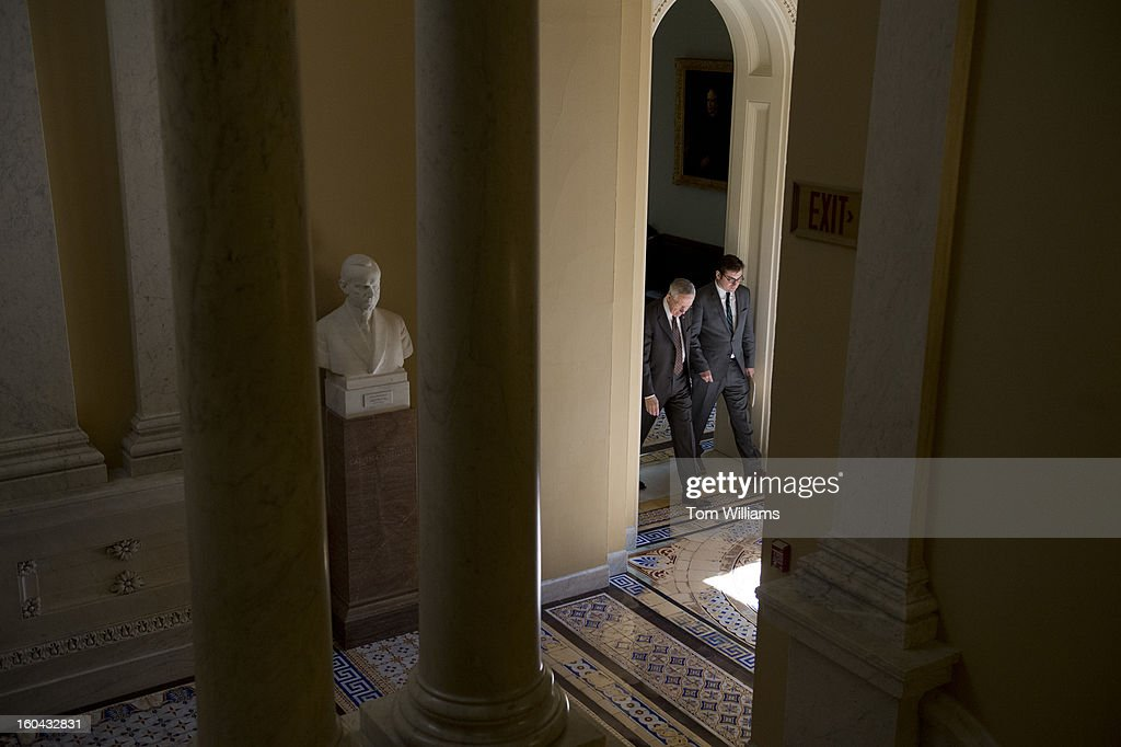 Senate Majority Leader Harry Reid, D-Nev., and communications director Adam Jentleson, make their way back to Reid's office after a news conference in the Capitol on immigration reform.