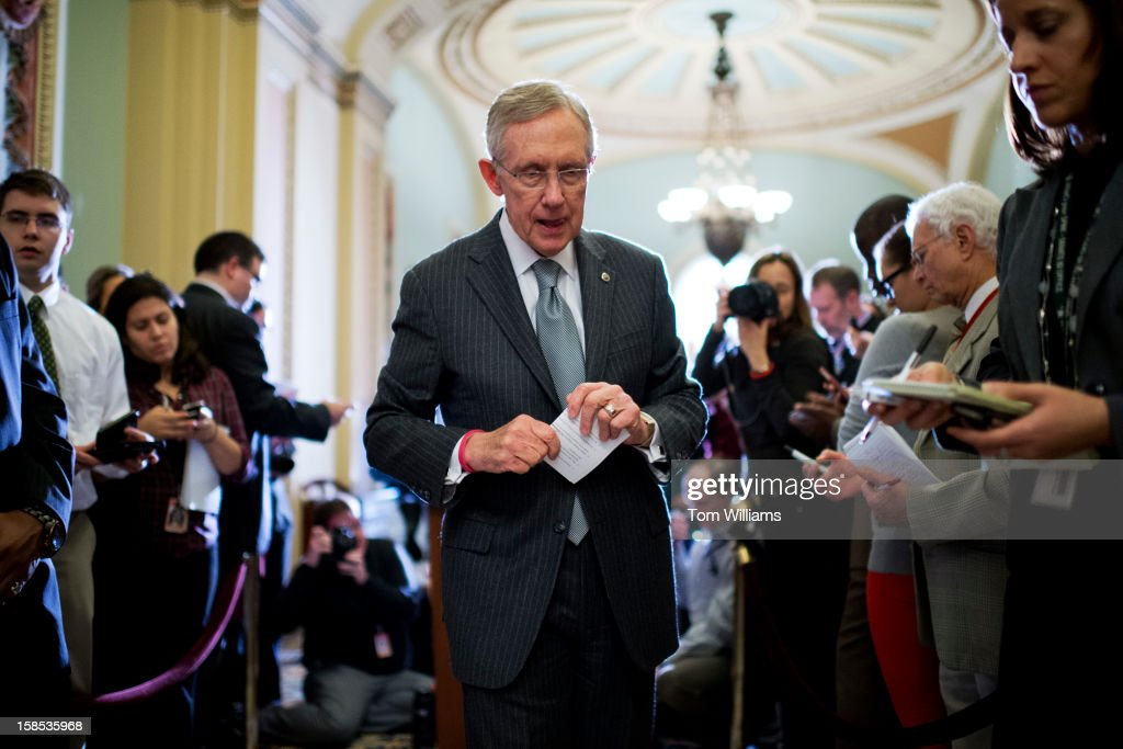 Senate Majority Leader Harry Reid, D-Nev., leaves a news conference in the Ohio Clock Corridor after the senate luncheons in the Capitol.