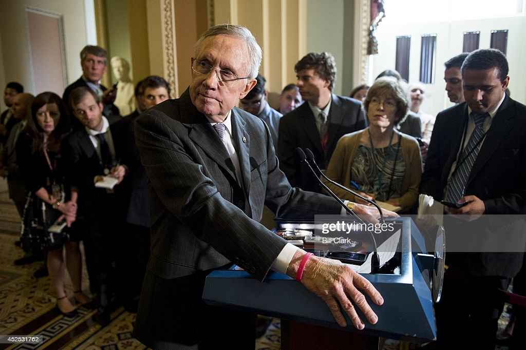 Senate Majority Leader Harry Reid DNev listens to a question from a reporter in the Ohio Clock Corridor in the Capitol on Tuesday July 22 2014