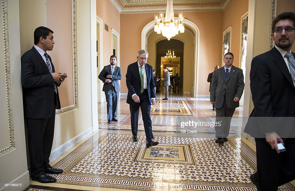 Senate Majority Leader Harry Reid DNev walks to the Ohio Clock Corridor to speak to the media following the Senate Democrats' policy lunch on Tuesday...
