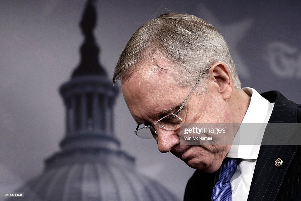 Senate Majority Leader Harry Reid finishes speaking at a press conference at the US Capitol January 16 2014 in Washington DC Reid and other Senate...