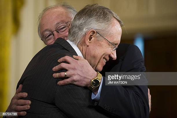 Senate Majority Leader Harry Reid is hugged by Secretary of the Interior Ken Salazar after US President Barack Obama signed HR 146 the Omnibus Public...