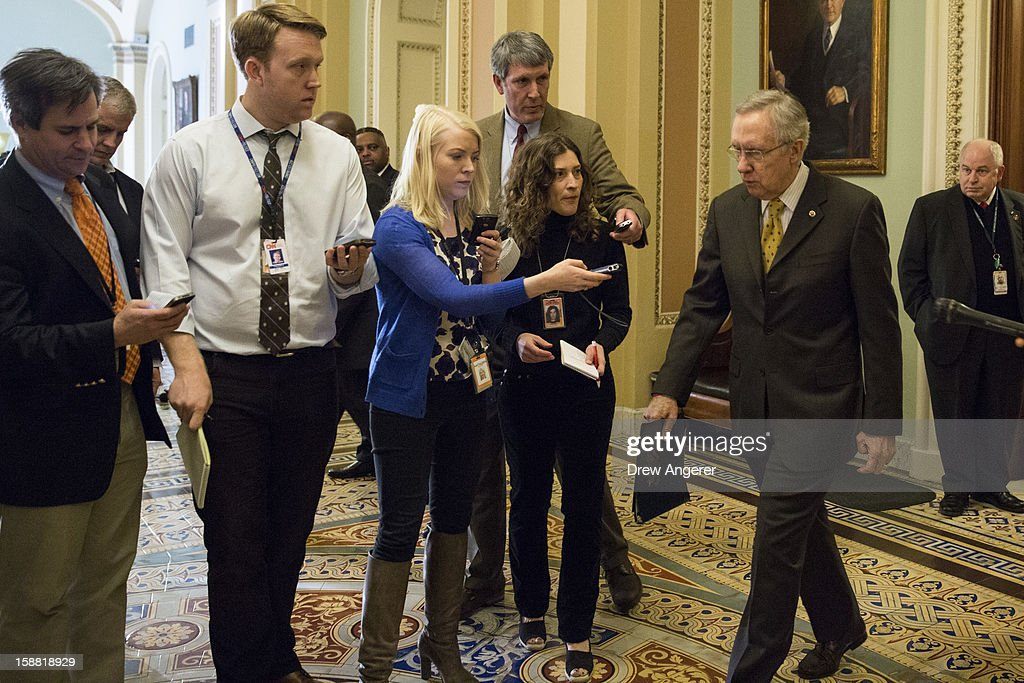 Senate Majority Leader <a gi-track='captionPersonalityLinkClicked' href=/galleries/search?phrase=Harry+Reid+-+Pol%C3%ADtico&family=editorial&specificpeople=203136 ng-click='$event.stopPropagation()'>Harry Reid</a> (D-NV) (R) leaves the Senate Chamber, on Capitol Hill, on December 30, 2012 in Washington, DC. The House and Senate are both in session today to deal with the looming 'fiscal cliff.' issue.