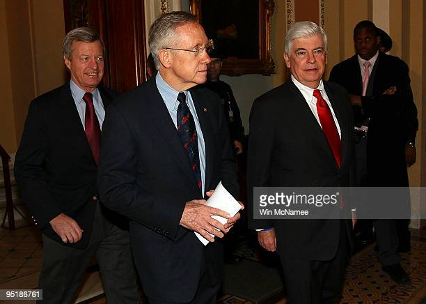 Senate Majority Leader Harry Reid leaves the Senate chamber with Sen Max Baucus and Sen Christopher Dodd following the final vote of the historic...