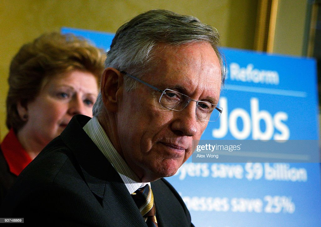U.S. Senate Majority Leader <a gi-track='captionPersonalityLinkClicked' href=/galleries/search?phrase=Harry+Reid+-+Politician&family=editorial&specificpeople=203136 ng-click='$event.stopPropagation()'>Harry Reid</a> (D-NV) (R) pauses as Sen. <a gi-track='captionPersonalityLinkClicked' href=/galleries/search?phrase=Debbie+Stabenow&family=editorial&specificpeople=221624 ng-click='$event.stopPropagation()'>Debbie Stabenow</a> (D-MI) (L) listens during a news conference on Capitol Hill December 3, 2009 in Washington, DC. The Democratic Senate leaders held a news conference on how the Health Care Reform Bill will help the economy and create jobs.