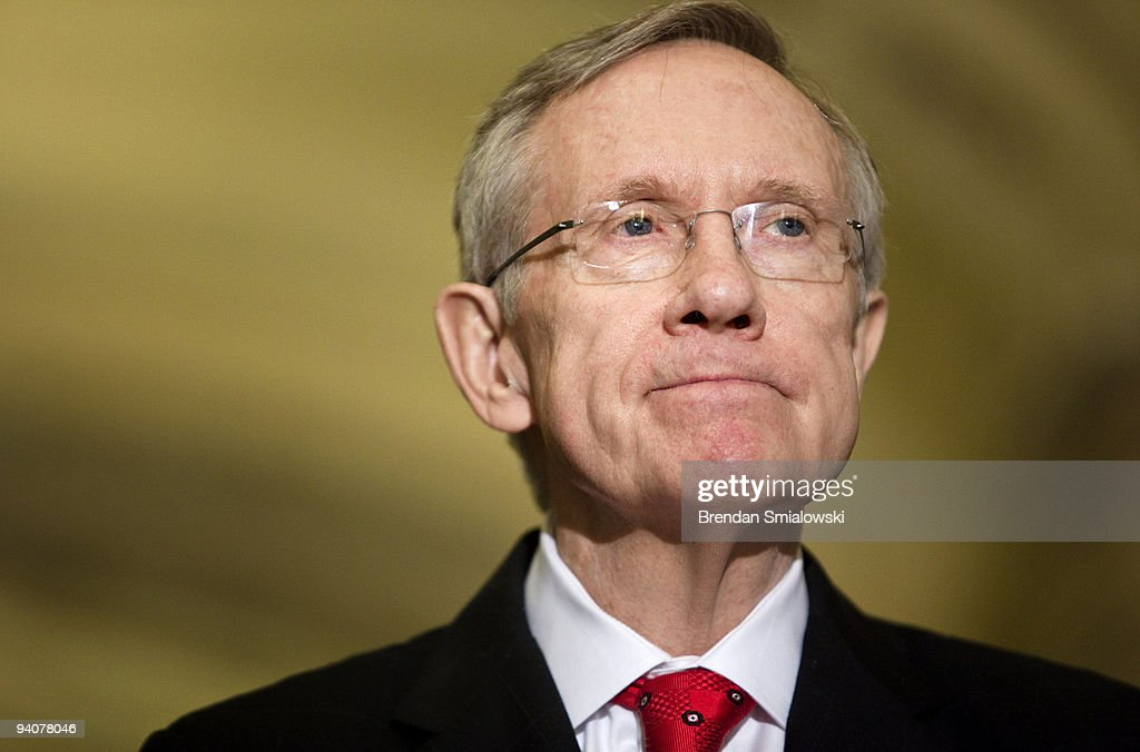 Senate Majority Leader Harry Reid pauses while speaking after a meeting with President Barack Obama and other Senate Democrats on Capitol Hill...
