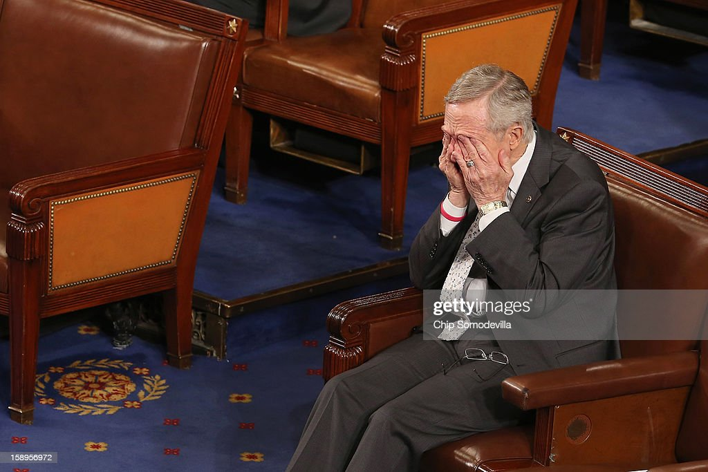 Senate Majority Leader <a gi-track='captionPersonalityLinkClicked' href=/galleries/search?phrase=Harry+Reid+-+Pol%C3%ADtico&family=editorial&specificpeople=203136 ng-click='$event.stopPropagation()'>Harry Reid</a> (D-NV) rubs his eyes during the counting of the Electorial College votes from the 50 states in the House of Representatives chamber at the U.S. Capitol January 4, 2013 in Washington, DC. The votes were tallied during a joint session of the 113th Congress. President Barack Obama and Vice President Joe Biden received 332 votes to be reelected.