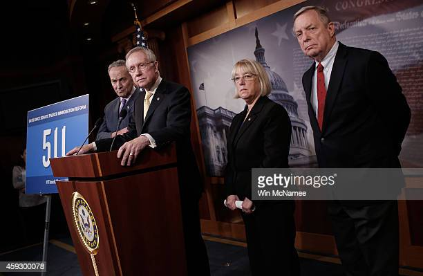 Senate Majority Leader Harry Reid Sen Charles Schumer Sen Patty Murray and Sen Dick Durbin speak during a press conference at the US Capitol on...