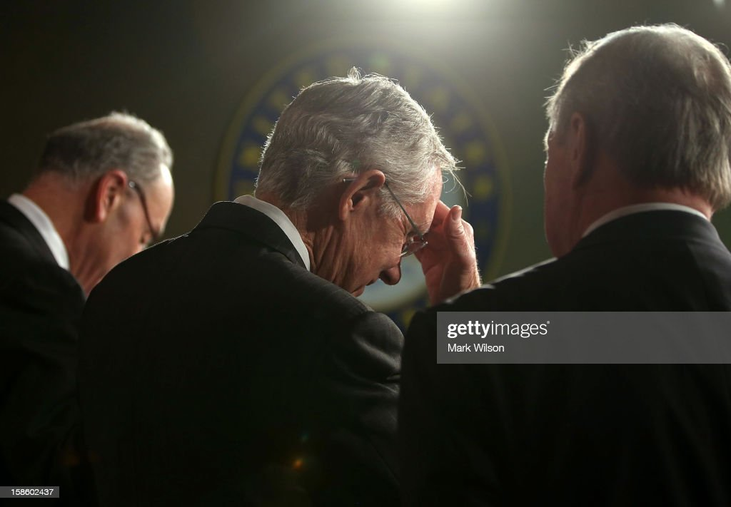 Senate Majority Leader Harry Reid Sen Richard Durbin and Sen Charles Schumer participate in a news conference on Capitol Hill December 20 2012 in...