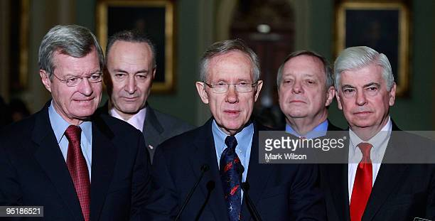 Senate Majority Leader Harry Reid speaks amidst Sen Max Baucus Sen Charles Schumer Sen Reid Sen Richard Durbin Sen Christopher Dodd after the US...