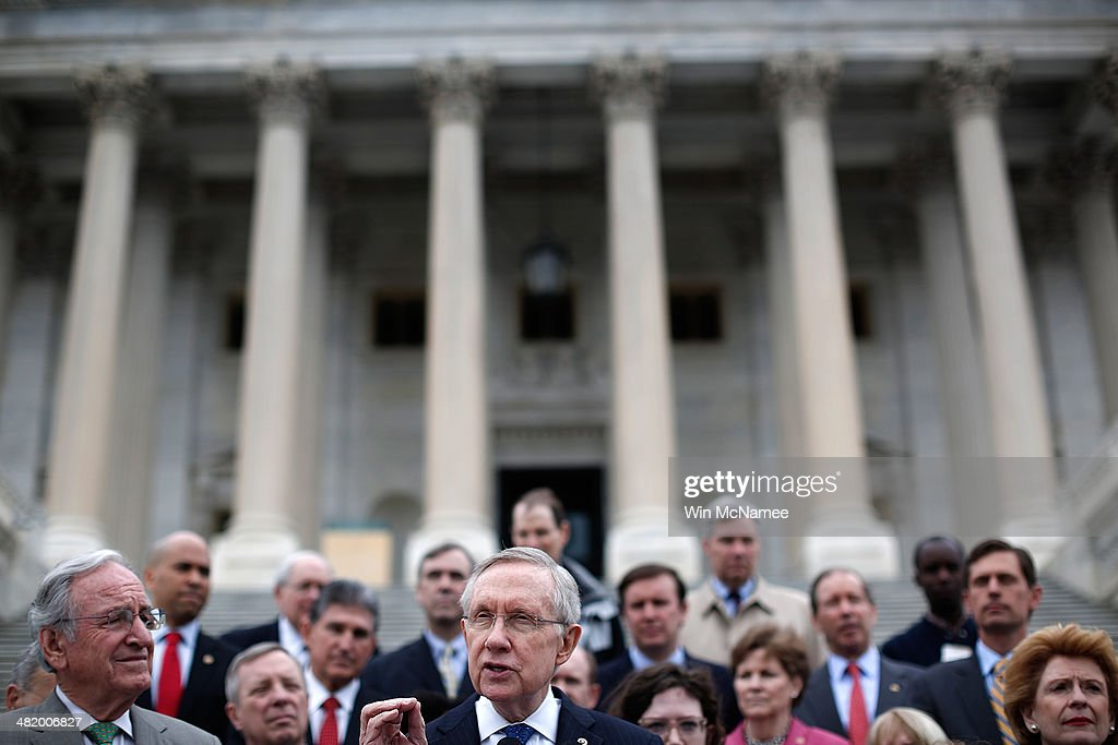 Senate Majority Leader Harry Reid speaks at a press conference outside the US Capitol April 2 2014 in Washington DC During the press conference...