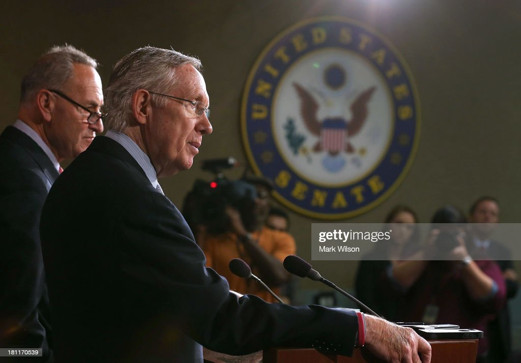 Senate Majority Leader <a gi-track='captionPersonalityLinkClicked' href=/galleries/search?phrase=Harry+Reid+-+Politician&family=editorial&specificpeople=203136 ng-click='$event.stopPropagation()'>Harry Reid</a> (D-NV) (R) speaks during a news conference with Sen. Chuck Schumer (D-NY) on Capitol Hill, September 19, 2013 in Washington, DC. Leader Reid spoke about the continuing resolution and Republican efforts to defund Obamacare.