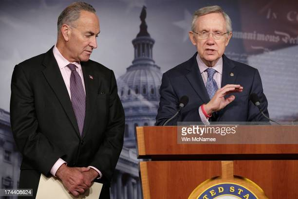 Senate Majority Leader Harry Reid speaks during a press conference at the US Capitol with Sen Charles Schumer July 25 2013 in Washington DC Members...