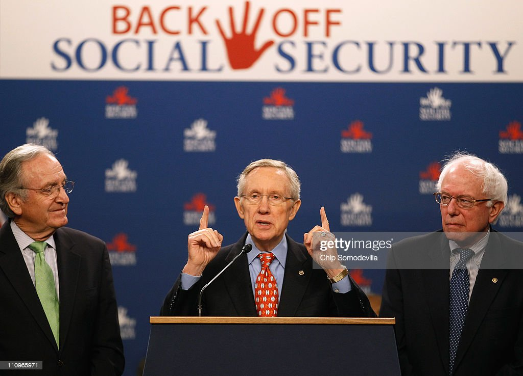 Senate Majority Leader <a gi-track='captionPersonalityLinkClicked' href=/galleries/search?phrase=Harry+Reid+-+Homme+politique&family=editorial&specificpeople=203136 ng-click='$event.stopPropagation()'>Harry Reid</a> (D-NV) (C) speaks during a rally in support of Social Security with Sen. <a gi-track='captionPersonalityLinkClicked' href=/galleries/search?phrase=Tom+Harkin&family=editorial&specificpeople=211373 ng-click='$event.stopPropagation()'>Tom Harkin</a> (D-IA) (L) and Sen. <a gi-track='captionPersonalityLinkClicked' href=/galleries/search?phrase=Bernie+Sanders&family=editorial&specificpeople=2908340 ng-click='$event.stopPropagation()'>Bernie Sanders</a> (I-VT) in the Dirksen Senate Office Building on Capitol Hill March 28, 2011 in Washington, DC. The Democratic senators said the Republicans' entitlement reform plan will 'dismantle Social Security, delay distribution of benefits to seniors.'