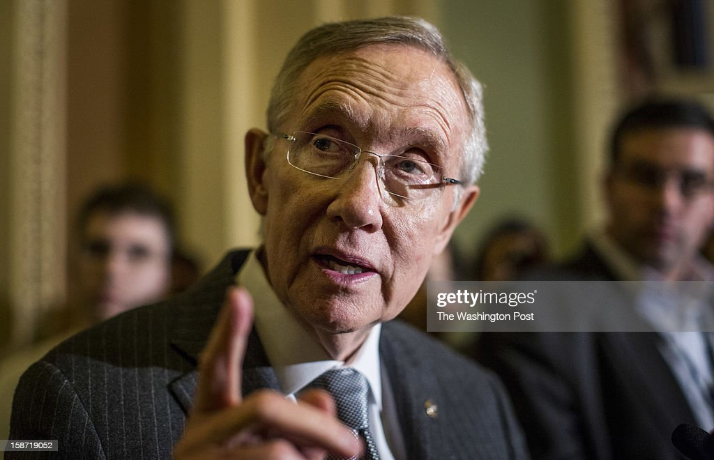 Senate Majority Leader Harry Reid (D-NV) speaks to crowds of reporters after the Senate policy luncheons concerning the ongoing fiscal cliff negotiations on Capitol Hill, Tuesday, December 18, 2012.