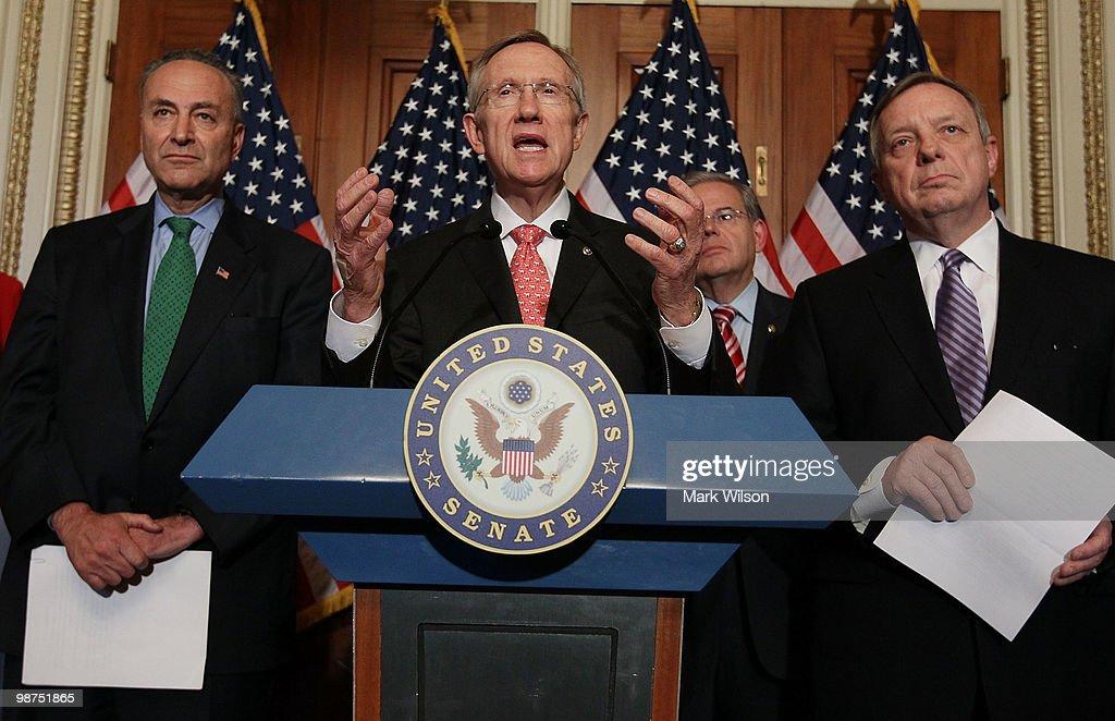 Senate Majority Leader Harry Reid speaks while flanked by Sen Richard Durbin Sen Robert Menendez and SenChuck Schumer during a news conference on...