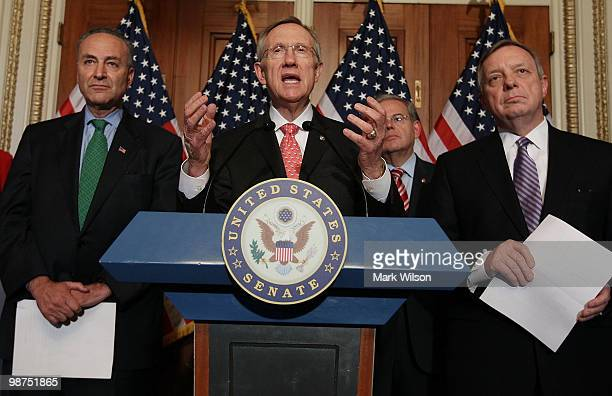 Senate Majority Leader Harry Reid speaks while flanked by Sen Richard Durbin Sen Robert Menendez and SenChuck Schumer during a news conference on...
