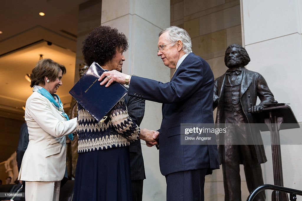 Senate Majority Leader <a gi-track='captionPersonalityLinkClicked' href=/galleries/search?phrase=Harry+Reid+-+Politician&family=editorial&specificpeople=203136 ng-click='$event.stopPropagation()'>Harry Reid</a> (D-NV) (R) speaks with Nettie Washington Douglass, great great granddaughter of Frederick Douglass, during a dedication ceremony for the new Frederick Douglass Statue in Emancipation Hall in the Capitol Visitor Center, at the U.S. Capitol, on June 19, 2013 in Washington, DC. The 7 foot bronze statue of Douglass joins fellow black Americans Rosa Parks, Martin Luther King Jr. and Sojourner Truth on permanent display in the Capitol's Emancipation Hall.
