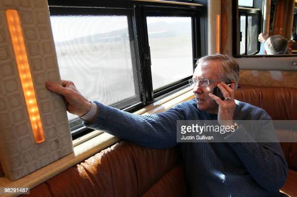 S Senate Majority Leader Harry Reid talks on his cell phone while riding on his campaign bus April 6 2010 in Stagecoach Nevada Sen Reid continues his...