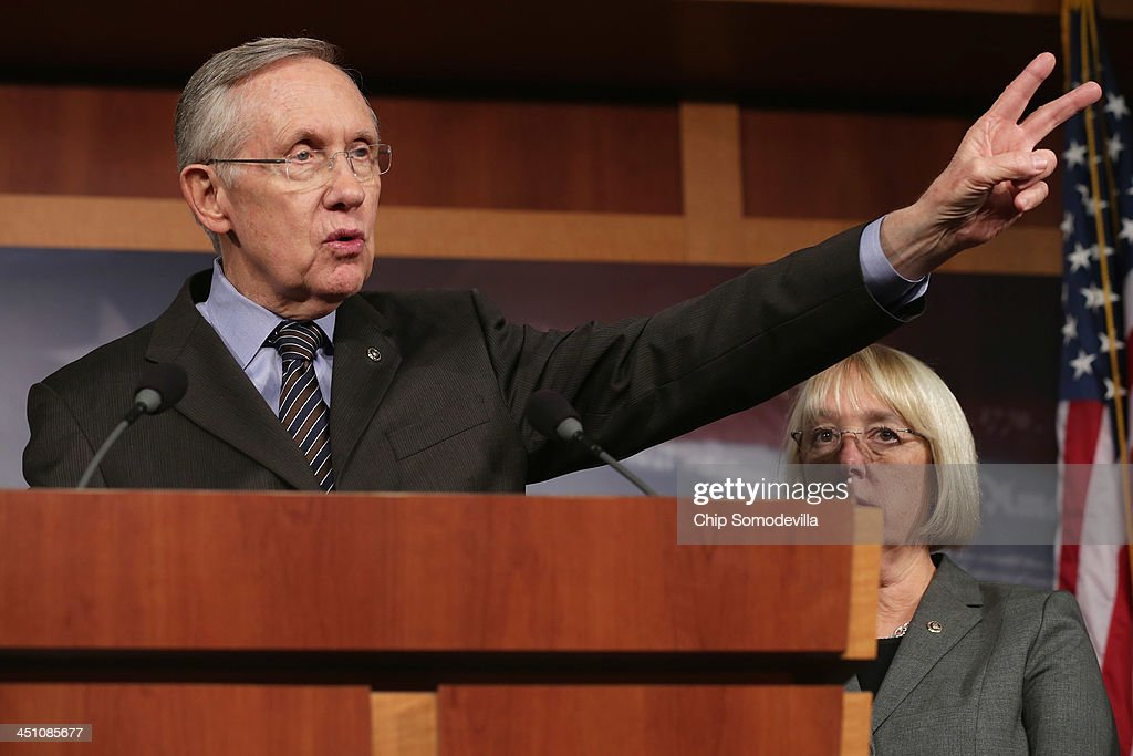 Senate Majority Leader <a gi-track='captionPersonalityLinkClicked' href=/galleries/search?phrase=Harry+Reid+-+Politician&family=editorial&specificpeople=203136 ng-click='$event.stopPropagation()'>Harry Reid</a> (D-NV) talks to reporters about the use of the 'nuclear option' with Senate Budget Committee Chair <a gi-track='captionPersonalityLinkClicked' href=/galleries/search?phrase=Patty+Murray&family=editorial&specificpeople=532963 ng-click='$event.stopPropagation()'>Patty Murray</a> (D-WA) at the U.S. Capitol November 21, 2013 in Washington, DC. The Senate voted 52-48 to invoke the so-called 'nuclear option', voting to change Senate rules on the controversial filibuster for most presidential nominations with a simple majority vote.