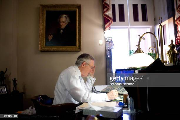 Senate Majority Leader Harry Reid talks with fellow Democratic Senators about their appearances on Sunday talk shows in his office on Capitol Hill on...