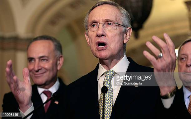 Senate Majority Leader Harry Reid talks with reporters after a Senate Democratic caucus meeting with Sen Charles Schumer and Senate Majority Whip...