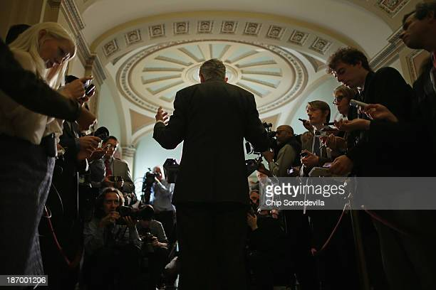 Senate Majority Leader Harry Reid talks with reporters after attending the weekly Senate Democratic Caucus policy luncheon at the US Capitol November...