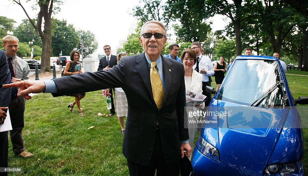 Senate Majority Leader Harry Reid (D-NV) tours a group of alternative energy vehicles on Capitol Hill June 12, 2008 in Washington, DC. Reid and other members of Congress spoke out on the need to develop new technologies that can help reduce U.S. dependence on oil. The blue car shown is the Tango electric car, produced by the Commuter Cars Corporation.