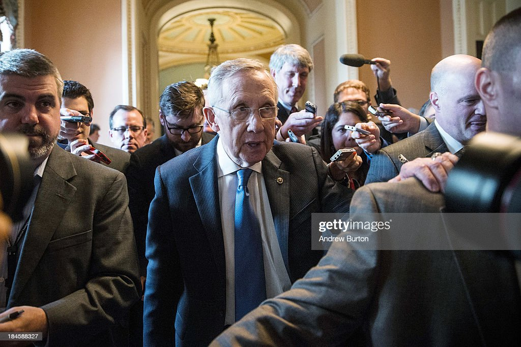 Senate Majority Leader <a gi-track='captionPersonalityLinkClicked' href=/galleries/search?phrase=Harry+Reid+-+Politician&family=editorial&specificpeople=203136 ng-click='$event.stopPropagation()'>Harry Reid</a> (D-NV) walks through the Capitol building on October 14, 2013 in Washington, DC. As Democratic and Republican leaders negotiate an end to the shutdown and a way to raise the debt limit, the White House postponed a planned Monday afternoon meeting with Boehner and other Congressional leaders.
