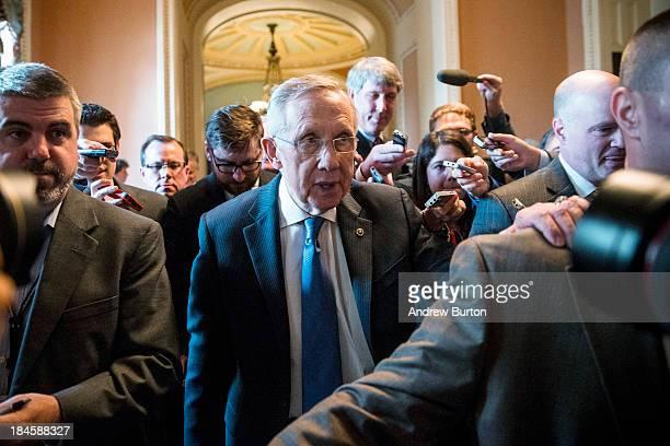 Senate Majority Leader Harry Reid walks through the Capitol building on October 14 2013 in Washington DC As Democratic and Republican leaders...