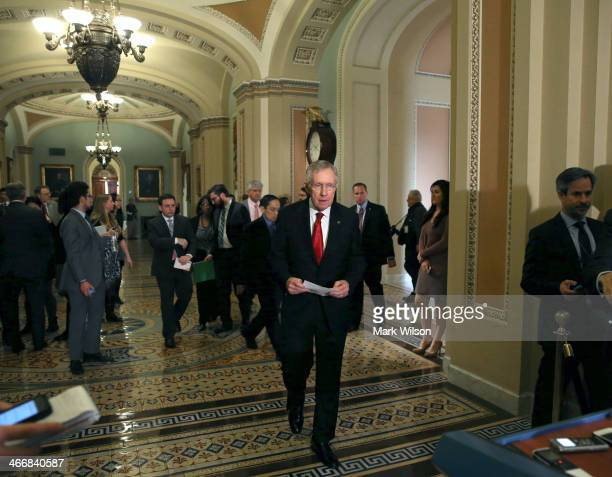 Senate Majority Leader Harry Reid walks up to spek to the media after attending the weekly Democrat policy luncheon at the US Capitol on February 4...