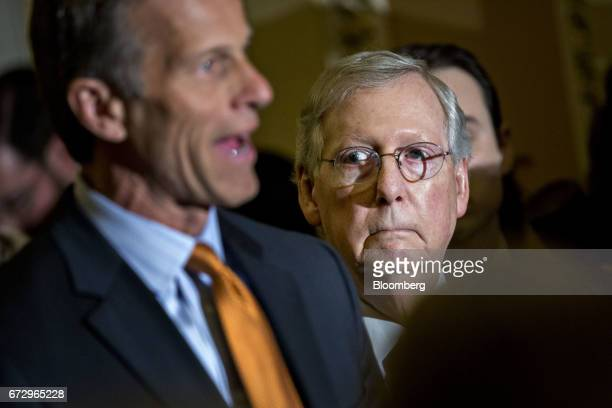 Senate Majority Leader Mitch McConnell a Republican from Kentucky listens as Senator John Thune a Republican from South Dakota left speaks during a...
