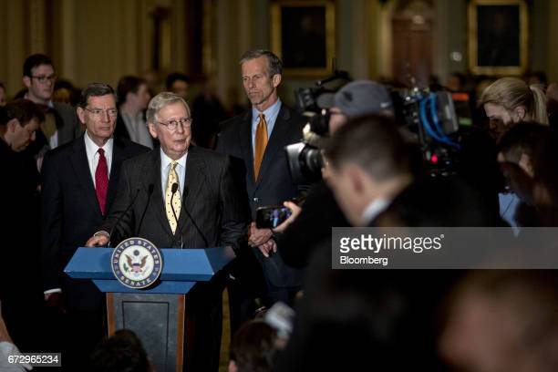 Senate Majority Leader Mitch McConnell a Republican from Kentucky speaks as Senator John Barrasso a Republican from Wyoming left and Senator John...