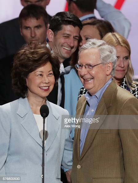 Senate Majority Leader Mitch McConnell along with his wife Elaine Chao and US Speaker of the House Paul Ryan speaks during a microphone test prior to...