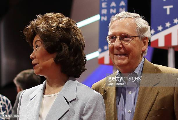 Senate Majority Leader Mitch McConnell along with his wife Elaine Chao look on a day before the start of the start of the Republican National...