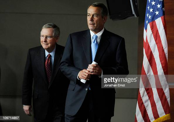 S Senate Majority Leader Mitch McConnell and House Speaker John Boehner arrive for news conference at the US Capitol on March 2 2011 in Washington DC...