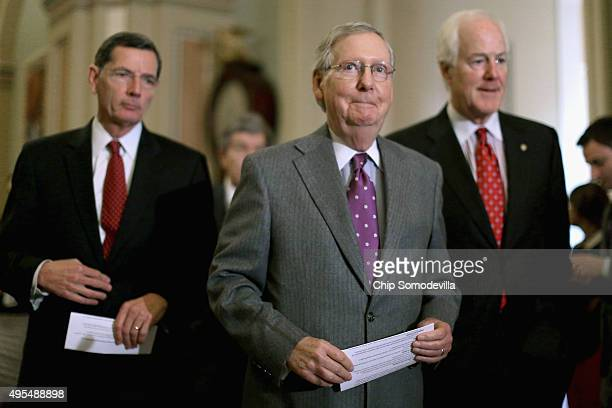 Senate Majority Leader Mitch McConnell and Sen John Barrasso and Senate Majority Whip John Cornyn talk to reporters following the weekly Senate GOP...