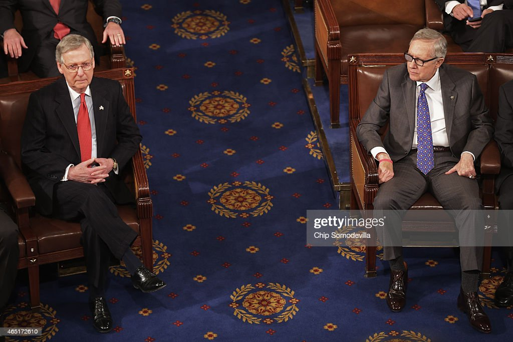 Senate Majority Leader <a gi-track='captionPersonalityLinkClicked' href=/galleries/search?phrase=Mitch+McConnell&family=editorial&specificpeople=217985 ng-click='$event.stopPropagation()'>Mitch McConnell</a> (R-KY) (L) and Senate Minority Leader <a gi-track='captionPersonalityLinkClicked' href=/galleries/search?phrase=Harry+Reid+-+Politician&family=editorial&specificpeople=203136 ng-click='$event.stopPropagation()'>Harry Reid</a> (D-NV) sit across the asile from each other in the House chamber ahead of Israeli Prime Minister Benjamin Netanyahu's address to a joint meeting of the United States Congress at the U.S. Capitol March 3, 2015 in Washington, DC. At the risk of further straining the relationship between Israel and the Obama Administration, Netanyahu warned members of Congress against what he considers an ill-advised nuclear deal with Iran.
