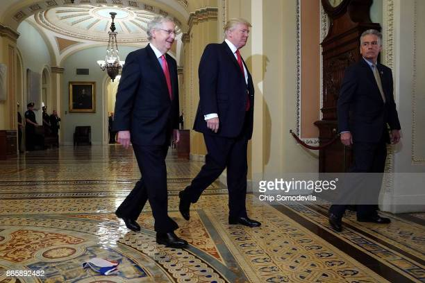 Senate Majority Leader Mitch McConnell and US President Donald Trump arrive for the Republican Senate Policy Luncheon and walk past a Russian flag on...